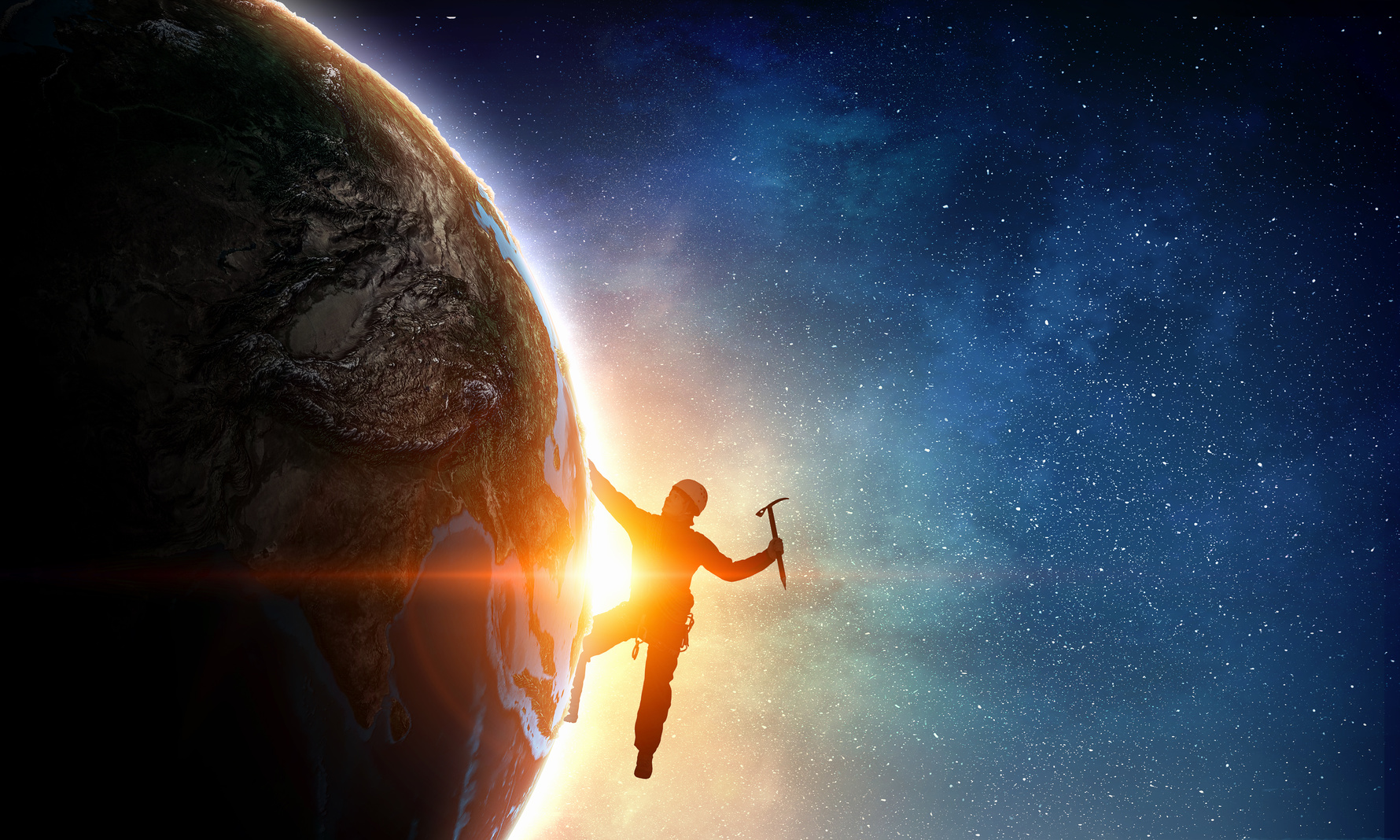 Silhouette of alpinist climbing Earth planet. Elements of this image are furnished by NASA