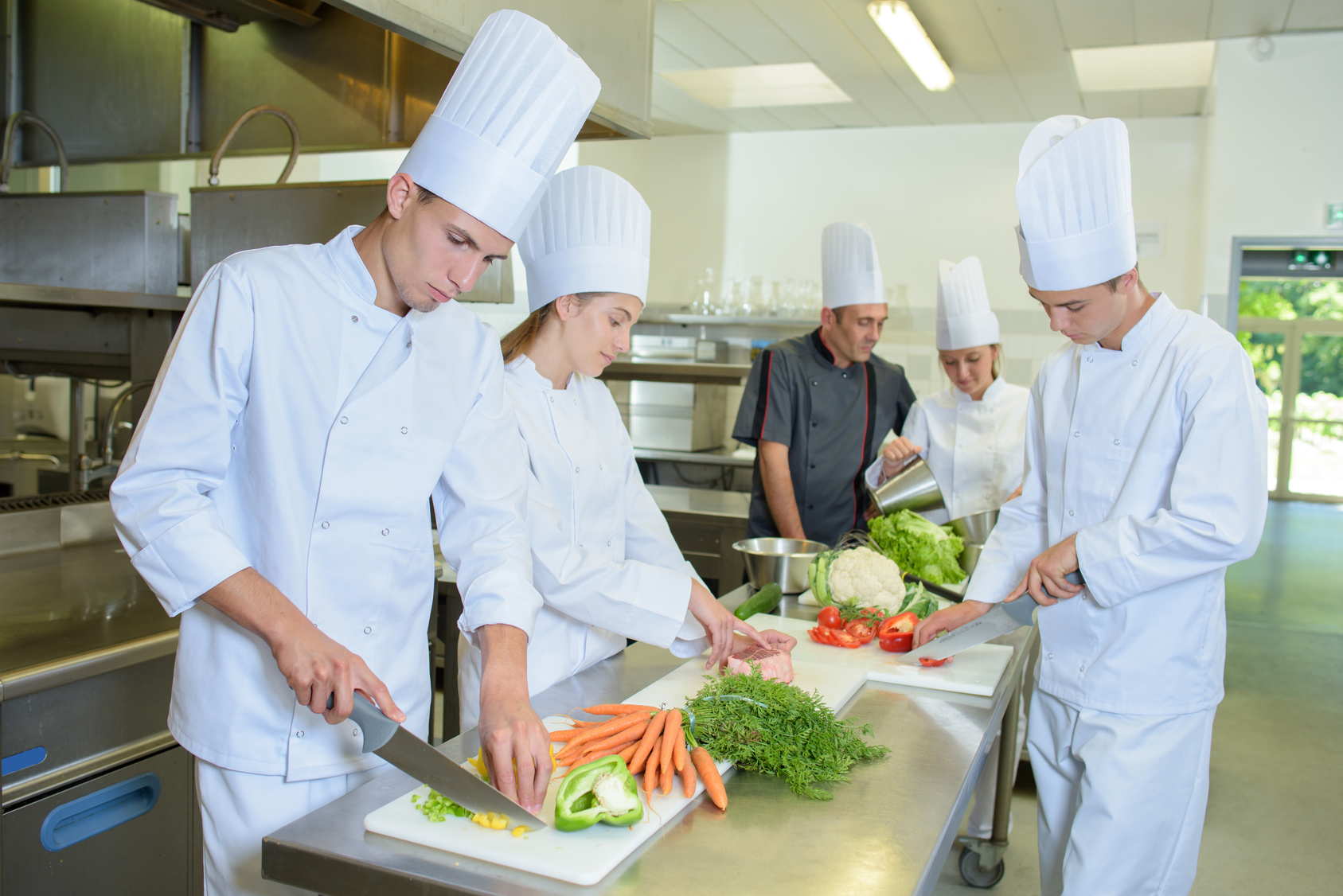 Chef supervising team of trainees